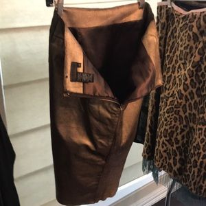 Gold %100 leather skirt.
